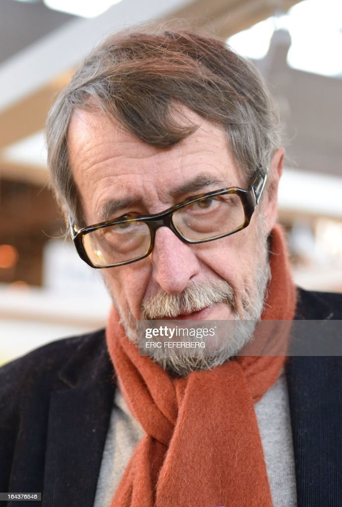 French writer Patrick Rambaud poses on March 23, 2013 during the signing at the Paris Book Fair of his book 'Tombeau de Nicolas I et avenement de Francois IV' ('Tomb of Nicolas I and advent of Francois IV').