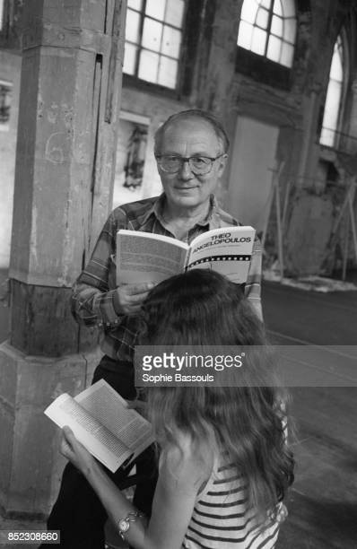 French writer Pierre Bourgeade reads from a book with a woman He is the author of essays novels and plays most notably 'Orden' produced in 1968 by...