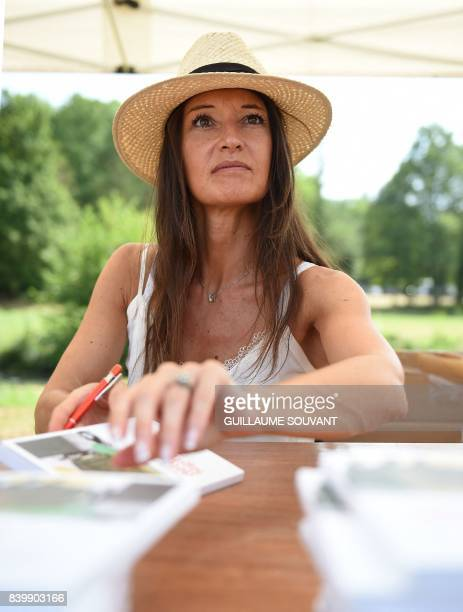 French writer Veronique Sousset signs books during the 22th La Foret Des Livres book fair on August 27 2017 in ChanceauxpresLoches central France La...
