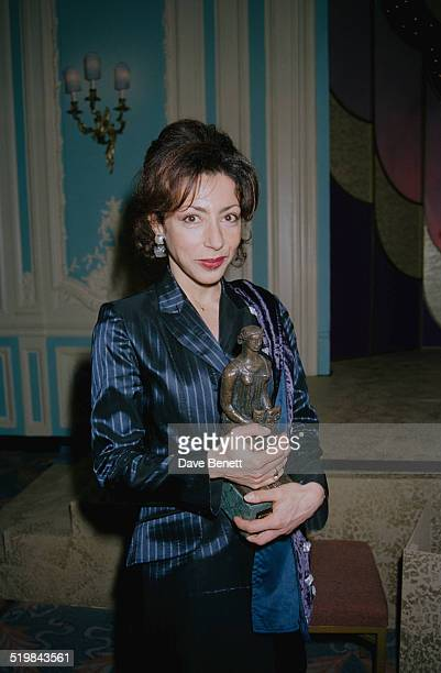 French writer Yasmina Reza with her Best Comedy award for 'Art' at the Evening Standard Theatre Awards held at the Savoy Hotel London 29th November...