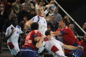 French Xavier Barachet tries to score despite Serbian Alem Toskic and Momit Ilic during the handball friendly match France vs Serbia on January 12...