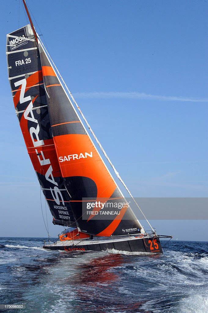 French yachtsman Marc Guillemot arrives with his 'Safran' monohull in La Trinite-sur-Mer, western France, on July 7, 2013 after establishing a new record across the north Atlantic Ocean. Guillemot set a new record for a solo, single-hulled crossing of the north Atlantic Ocean, slicing more than 15 hours off the previous mark. AFP PHOTO / FRED TANNEAU