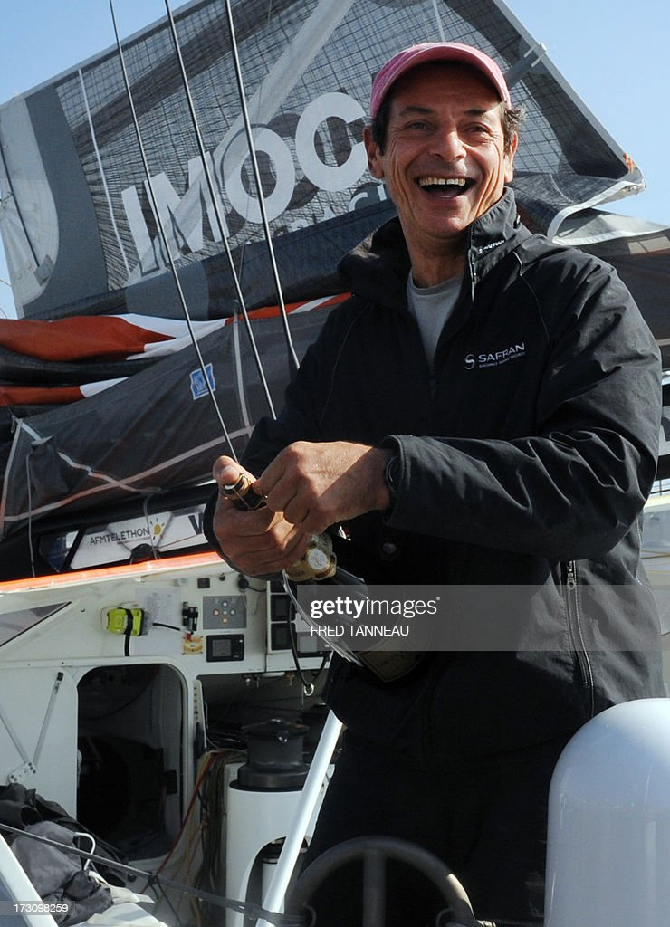 French yachtsman Marc Guillemot celebrates after arriving with his 'Safran' monohull on July 7, 2013 in La Trinite-sur-Mer, western France. Guillemot set a new record for a solo, single-hulled crossing of the north Atlantic Ocean, slicing more than 15 hours off the previous mark. AFP PHOTO / FRED TANNEAU