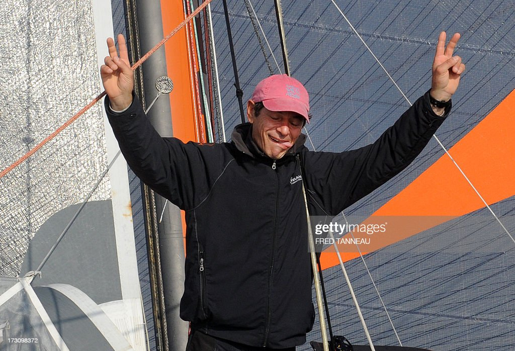 French yachtsman Marc Guillemot celebrates after arriving with his 'Safran' monohull on July 7, 2013 in La Trinite-sur-Mer, western France. Guillemot set a new record for a solo, single-hulled crossing of the north Atlantic Ocean, slicing more than 15 hours off the previous mark.