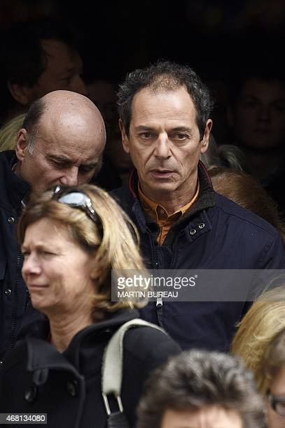 French yachtsman Marc Guillemot leaves SaintSeverin church after the funeral of French sailor Florence Arthaud in Paris on March 30 2015 The funeral...