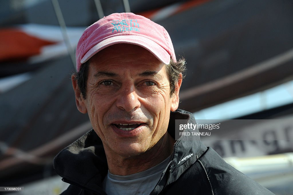 French yachtsman Marc Guillemot speaks to journalists upon his arrival on July 7, 2013 in La Trinite-sur-Mer, western France. Guillemot set a new record for a solo, single-hulled crossing of the north Atlantic Ocean, slicing more than 15 hours off the previous mark. AFP PHOTO / FRED TANNEAU