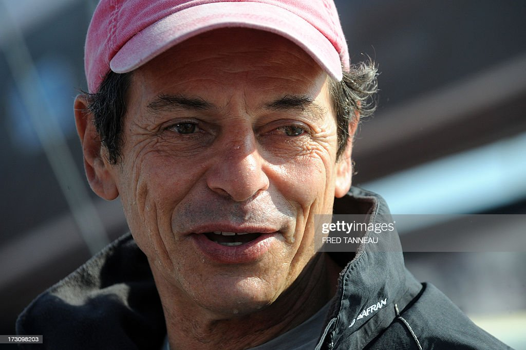 French yachtsman Marc Guillemot speaks to journalists upon his arrival on July 7, 2013 in La Trinite-sur-Mer, western France. Guillemot set a new record for a solo, single-hulled crossing of the north Atlantic Ocean, slicing more than 15 hours off the previous mark.
