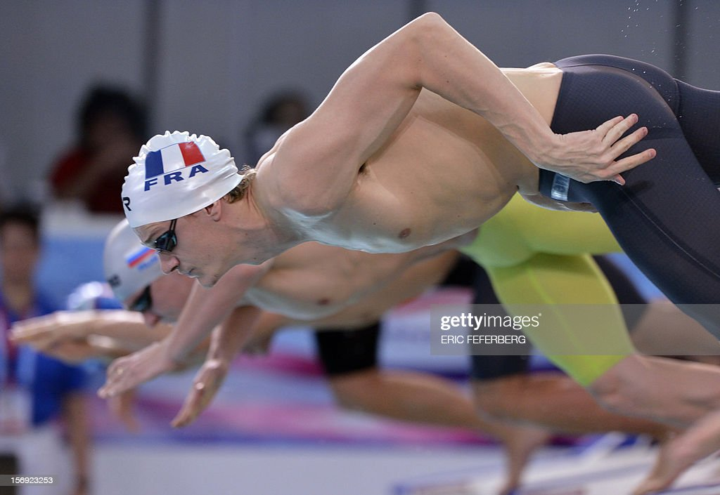 French Yannick Agnel takes the start of the men's 200m freestyle race on November 25, 2012 of the European short course swimming championships in the central French city of Chartres.