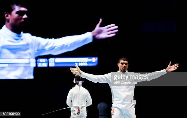 TOPSHOT French Yannick Borel celebrates after winning the team men's epee final between Switzerland and France at the World Fencing Championships on...