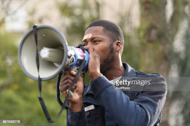 French youth worker Theo Luhaka address people during a rally against police violence organized by the Justice for Theo group outside the courthouse...