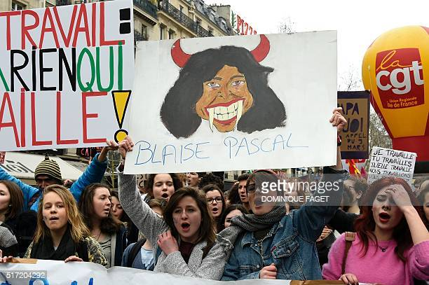 French youths and activists of various youth organisations march with a placard displaying a caricature of French mathematician and philosopher...