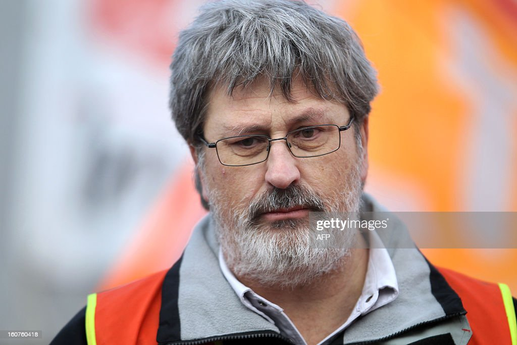 French Yvon Scornet, unions' spokeman of the Petroplus oil refinery, is pictured during a protest outside the Petroplus oil refinery, on February 5, 2013 in Petit-Couronne, northwestern France. A French court ordered last October the liquidation of Petit-Couronne oil refinery despite two offers for the site that employs 470 people. Investors have until this evening to make bids for the business, and the Minister for Industrial Regeneration Arnaud Montebourg said on RTL radio early in the day that the government expected several offers.
