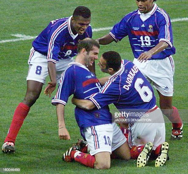 French Zinedine Zidane is congratulated by Youri Djorkaeff Marcel Desailly and Christian Karembeu after Zidane scored the second goal for his team 12...