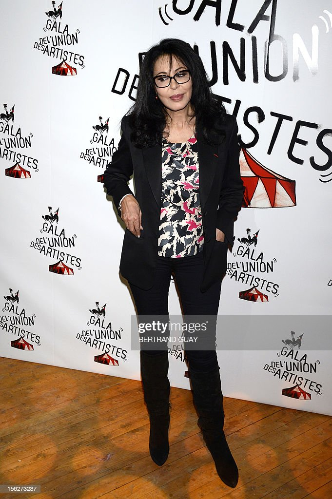 French-Algerian film director and French junior minister for La Francophonie Yamina Benguigui poses on arrival to the 50th edition of the 'Gala de l'union des Artistes' held at the Alexis Gruss circus in Paris on November 12, 2012.