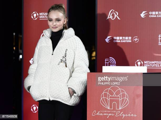 FrenchAmerican actress and model LilyRose Depp poses before officially switching on the Champs Elysees Christmas lights on the Champs Elysees avenue...