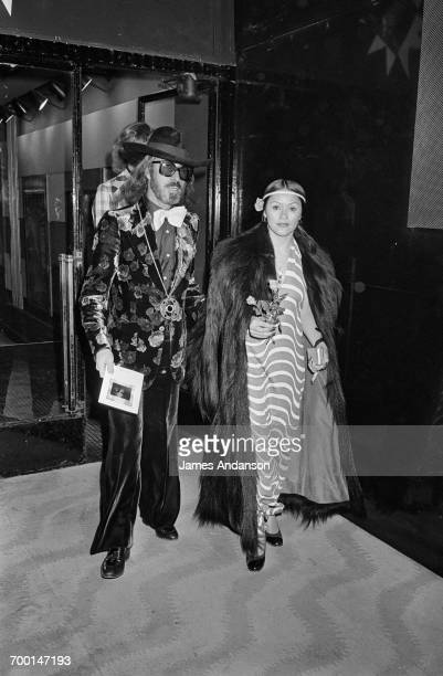 FrenchAmerican art dealer Fernand Legros arriving with Raimunda Biggs at a concert by singer Gilbert Becaud at the Olympia Paris 23d October 1975 For...