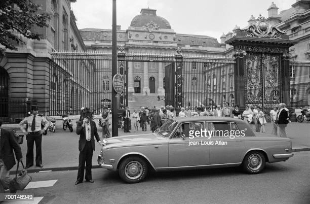 FrenchAmerican art dealer Fernand Legros posing with his Rolls Royce car in front of the Palais de Justice Paris after receiving a twomonth prison...