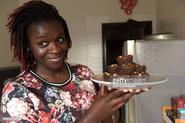 FrenchBeninese former journalist and Senegalbased blogger Karelle VignonVullierme presents a plate with selfmade pastry in her kitchen in Dakar on...