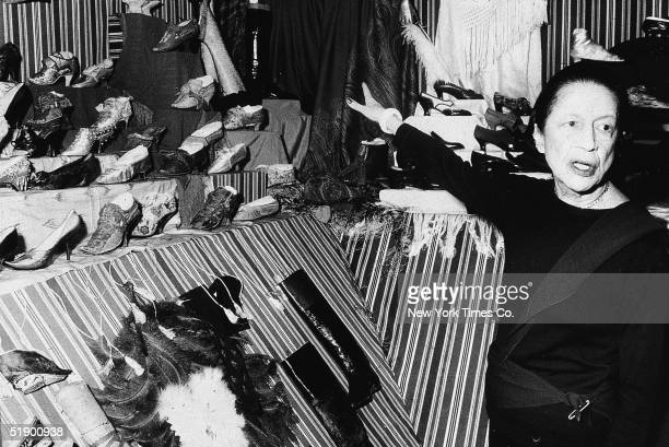Frenchborn fashion editor Diana Vreeland a special consultant to the Metropolitan Museum of Art gestures towards a shoe display that forms part of an...
