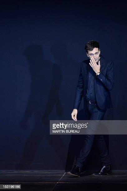 Frenchborn Hedi Slimane for Saint Laurent acknowledges the public during the Spring/Summer 2013 readytowear collection show on October 1 2012 in...