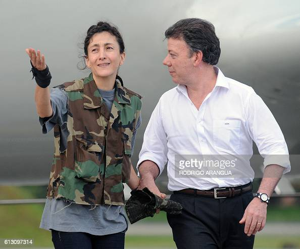 FrenchColombian hostage Ingrid Betancourt gestures next to Colombian defense Minister Juan Manuel Santos upon her arrival at the Catam air base in...