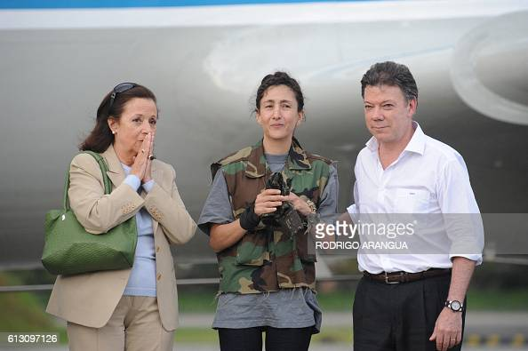FrenchColombian hostage Ingrid Betancourt gestures next to her mother Yolanda Pulecio and Colombian defense Minister Juan Manuel Santos upon her...