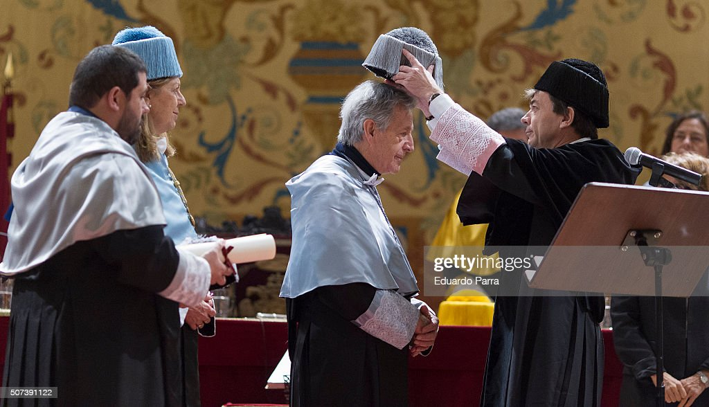 French-Greek director Costa Gavras (2R) is awarded the Doctor Honoris Causa at Computense University Auditorium on January 29, 2016 in Madrid, Spain.