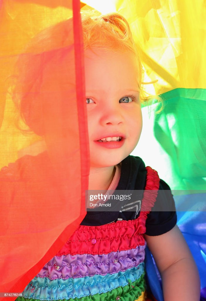 Frenchie Thomson looks out from her rainbow flag towards her grandmother on November 15, 2017 in Sydney, Australia. Australians have voted for marriage laws to be changed to allow same-sex marriage, with the Yes vote claiming 61.6% to to 38.4% for No vote. Despite the Yes victory, the outcome of Australian Marriage Law Postal Survey is not binding, and the process to change current laws will move to the Australian Parliament in Canberra.