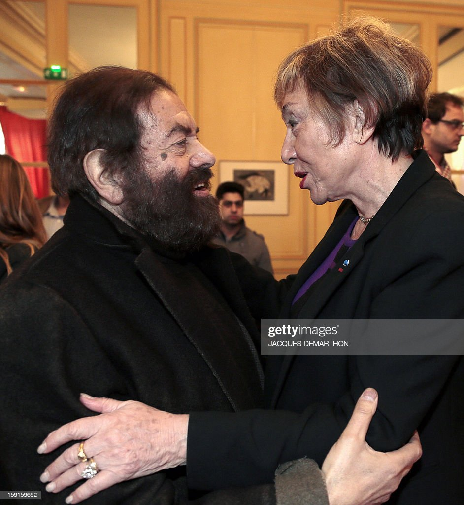 French-Jewish writer Marek Halter (L) speaks with Bulgarian-French philosopher and writer Julia Kristeva during the Simone de Beauvoir awards ceremony, in Paris on January 9, 2013. The 2013 Simone de Beauvoir prize for the freedom of women was handed to Malala Yousafzai, the young Pakistani schoolgirl activist who was the victim of an assasination attempt by the Taliban in 2012 and become a symbol of the struggle for girls' education and women's rights in Pakistan. Malala was flown to the United Kingdom with a life-threatening head wound shortly after her attack but recovered from her injuries and was temporarily discharged on January 4 as she awaits more surgery.