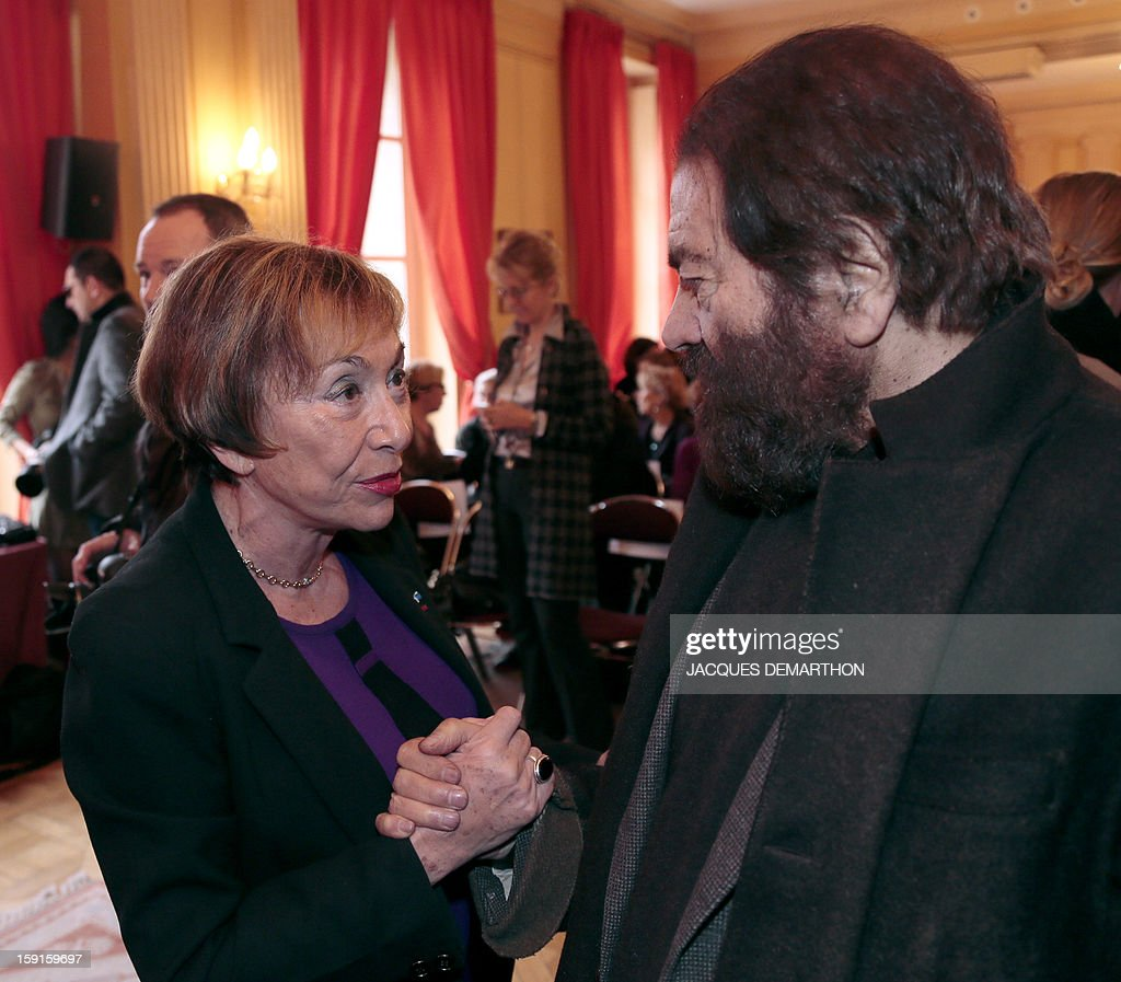 French-Jewish writer Marek Halter (R) speaks with Bulgarian-French philosopher and writer Julia Kristeva during the Simone de Beauvoir awards ceremony, in Paris on January 9, 2013. The 2013 Simone de Beauvoir prize for the freedom of women was handed to Malala Yousafzai, the young Pakistani schoolgirl activist who was the victim of an assasination attempt by the Taliban in 2012 and become a symbol of the struggle for girls' education and women's rights in Pakistan. Malala was flown to the United Kingdom with a life-threatening head wound shortly after her attack but recovered from her injuries and was temporarily discharged on January 4 as she awaits more surgery.