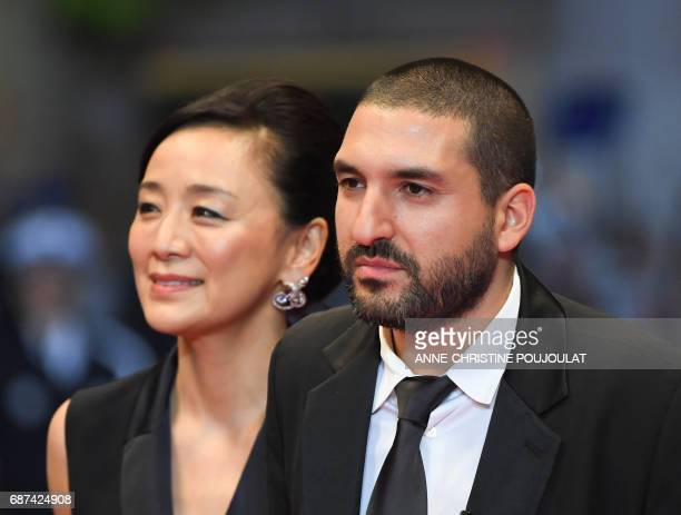 FrenchLebanese musician Ibrahim Maalouf arrives on May 23 2017 with Japanese actress Misuzu Kanno for the screening of the film 'Hikari' at the 70th...
