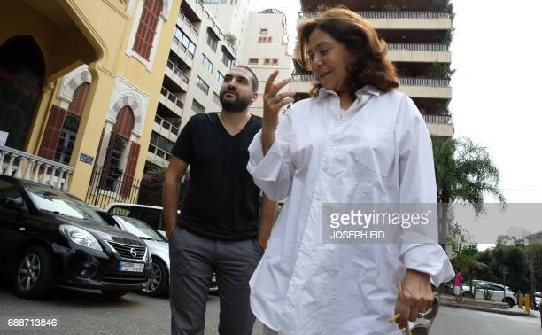 FrenchLebanese trumpet player teacher composer and arranger Ibrahim Maalouf walks down a street in Beirut with President of Baalbeck International...