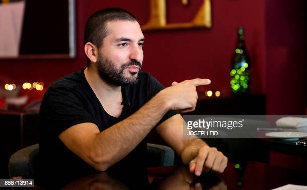 FrenchLebanese trumpet player teacher composer and arranger Ibrahim Maalouf speaks during an interview with an AFP journalist in Beirut on May 25...