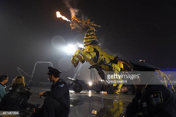 A Frenchmade 'Long Ma' a mechanical dragon horse spews fire during a performance between the Bird's Nest National Stadium and Water Cube in Beijing...