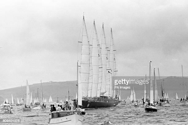Frenchman Alain Colas' massive 236ft schooner Club Mediterranee dwarfs the armada of accompanying craft as the transatlantic race fleet gets under...