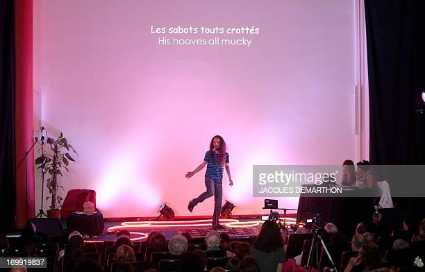 Frenchman Eupédien Deschardins takes part on June 4 2013 in Paris in the first round of the World Cup of poetry slam held until June 9 AFP PHOTO /...
