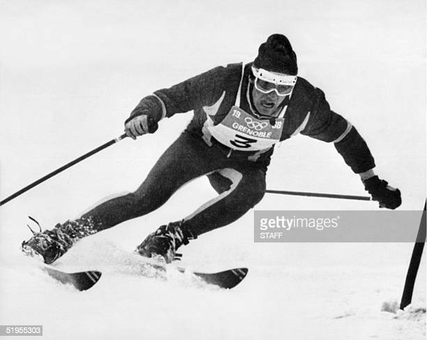 Frenchman JeanClaude Killy clears a gate during the second run of the men's giant slalom 12 February 1968 in Chamrousse near Grenoble during the...