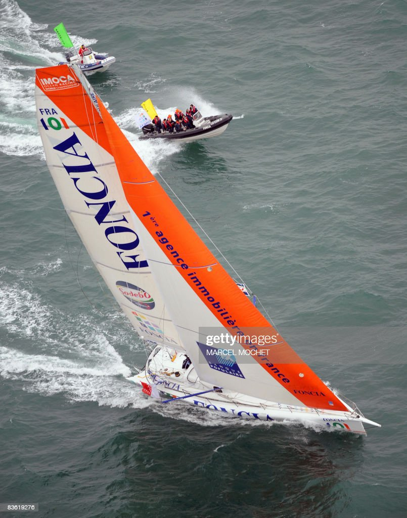 Frenchman Micherl Desjoyeaux skipper of the monohull Foncia takes the start of the 6th edition of the gruelling roundtheworld yacht race Vendee Globe...