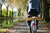 Frenchman on bike with baguettes