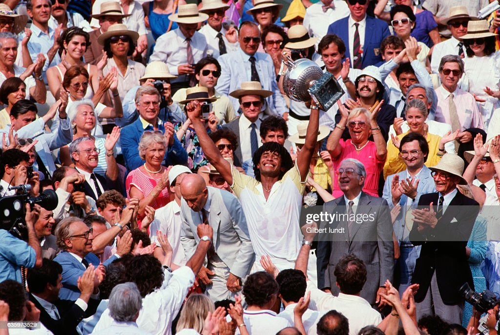 Frenchman Yannick Noah is overwhealmed by his victory in the 1983 French Open.   Location: Auteuil, France.