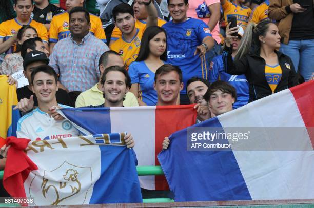 Frenchmen cheer for Tigres where fellow countryman Andre Gignac plays during the Mexican Apertura football tournament match against Leon at the Nou...