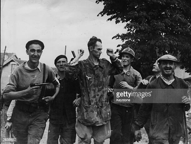 Frenchmen taking part in the capture of Chartres bring out a Luftwaffe man who has surrendered