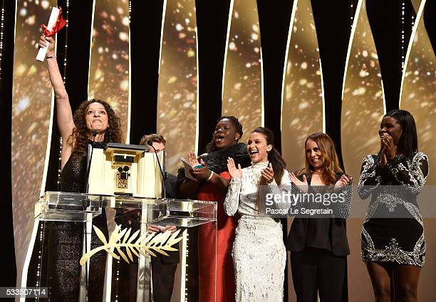 FrenchMoroccan director Houda Benyamina celebrates on stage with the cast of her film after being awarded with the Camera d'Or for the film 'Divines'...