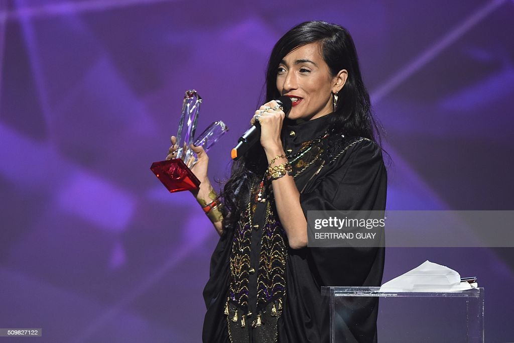 French-Moroccan singer Hindi Zahra speaks after receiving the best world music album award during the 31st Victoires de la Musique, the annual French music awards ceremony, on February 12, 2016 at the Zenith concert hall in Paris. AFP PHOTO / BERTRAND GUAY / AFP / BERTRAND GUAY
