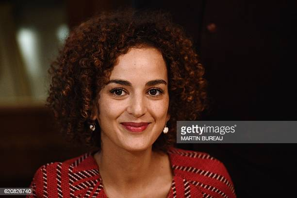 FrenchMoroccan writer Leila Slimani smiles at Le Drouant restaurant in Paris during a meeting with the press after winning France's Goncourt literary...
