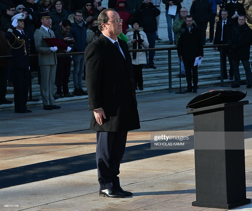 FrenchPresident Francois Hollande stands after bestowing the Honor of Legion to the Unknown Soldier of WWII at the Tomb of the Unknowns at Arlington...