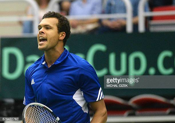 French's JoWilfried Tsonga reacts during his match against Czech Republic's Lukas Rosol at the International Tennis Federation Davis Cup quarterfinal...