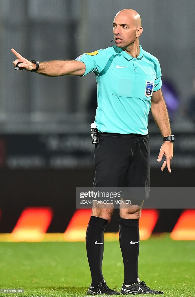 French's referee Bartolomeu Varela gestures during the French L1 football match between Angers (SCO) and Toulouse (TFC) on October 22, 2016, at the Jean Bouin Stadium in Angers, northwestern France. / AFP / JEAN