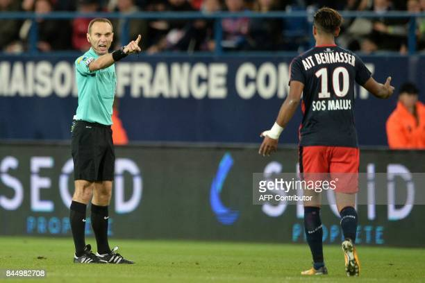 French's referee Thomas Leonard gestures to Caen's FrenchMoroccan midfielder Youssef Ait Bennasser during the French L1 football match between Caen...
