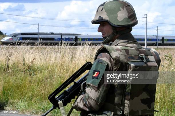 A French's soldier of the Sentinelle operation stands guard as he takes part in a simulation of a terror attack during a training exercise of the...